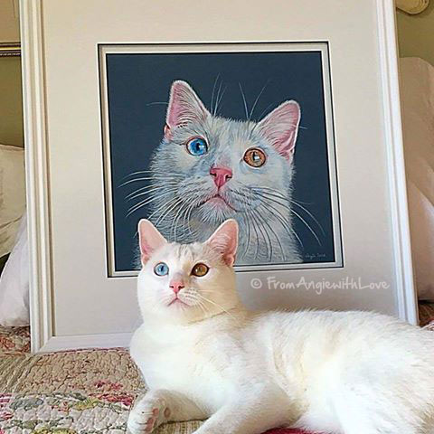 Boz and his beautifully-framed portrait.